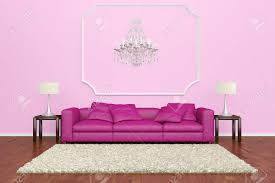 Pink Sofa With Chandelier And Brown Carpet On Wooden Floor