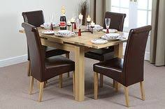 x solid oak extending dining table 4 brown leather chairs seats up to 6 people extended