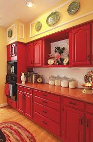 Red Cabinets paired with Pale Yellow Walls and White Subway Tile Backspalsh