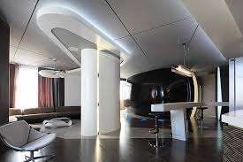 In this interior form is dictating the space, it looks more like a  spaceship rather than an apartment for ...