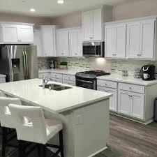 white shaker kitchen cabinets with quartz countertops