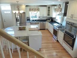 cape cod kitchen remodeling project features cliqstudios com lyndale raised panel cabinets in painted white