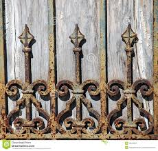 photo about rust and chipping paint add grungy detail to this old wrought iron gate