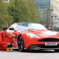 vanquish car. at canarywharflondon hereu0027s a shot from earlier in the week of little tj grant morden admiring aston martin vanquish s red arrows car