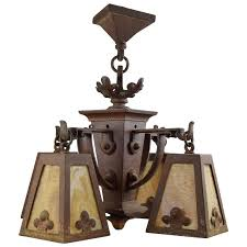 hammered iron chandelier with slag glass shades for