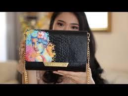 painting on a luxury leather handbag