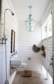 farmhouse outdoor shower with a turquoise chandelier