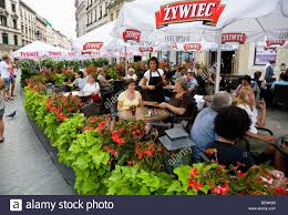Outdoor restaurant tables in rynek glowny the main market square markt square krakow poland