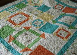 8 Baby Boy Quilt Patterns That'll Bring You Joy & monkey quilt pattern featuring free motion quilting, on Craftsy Adamdwight.com