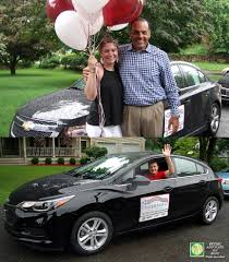 videos photos surprise ingersoll presents three cars not one sophie morton holding balloons as she poses todd ingersoll owner of ingersoll auto of danbury after receiving a prize of a chevrolet cruise car