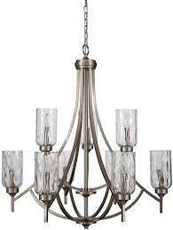 this brushed nickel nine light chandelier is part of the latchbury collection the textured glass shades provide ample illumination