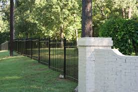 iron fence stair stepped to follow yard slope grade