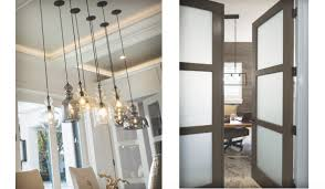 pendant lights above left add a whimsical touch to the breakfast area main entry and second floor game room the use of frosted glass panels above