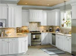 kitchen white wooden kitchen cabinet and cream wooden countertops added by beige tile backsplash