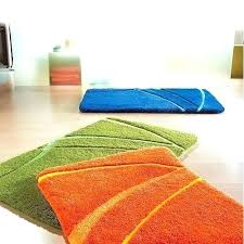 orange yellow green area rug and