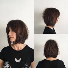 Rich Brunette Soft Layered Bob With Curtain Bangs And Undone