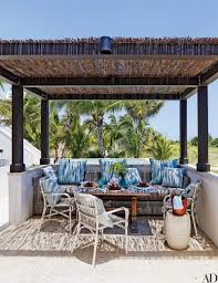 decorator thomas scheerer roofed the pergola with bamboo fencing from in his bahamian vacation home