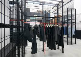 an area named the wire fence labyrinth is flanked by steel mesh walls and displays womenswear pieces from the likes of jacquemus jw anderson