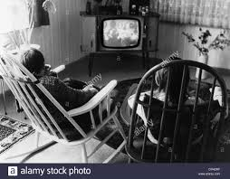 black kids watching tv. stock photo - broadcast, television, children watching tv, april 1972, 20th century, historic, historical, 1970s, 70s, watch televis black kids tv