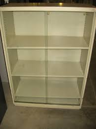 metal bookcase with glass doors used