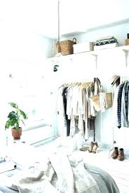 the most efficient way to hang your clothes in your closet how to hang clothes without