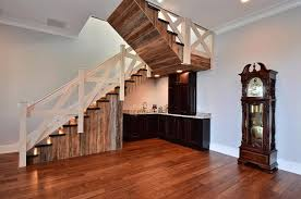 Rustic Staircase with High ceiling, Hardwood floors, Crown molding