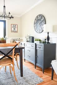 modern farmhouse dining room painted in sherwin williams iron ore and accessible beige
