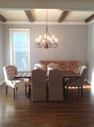 dining table parson chairs interior: traditional dining room design with beige parsons chairs and dark wood dining table plus crown chandelier