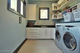 Contemporary Laundry Room With Ikea Orrnas Handle, Built In Bookshelf, Ikea  Grimslov Cabinets
