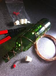 all you need is a wine bottle some heavy gauge copper wire wire cutters and some stopper feeder s i got mine off of here
