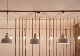 above copper pipes were used to create a floor to ceiling staircase barade screen as well as a decorative screen running along the face of the bar