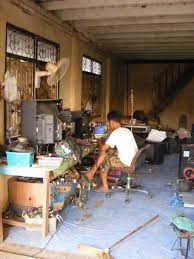 tv repair shop. file:tv repair shop in thailand.jpg tv e