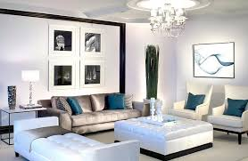 View in gallery Lavish black and white living room with posh blue accents
