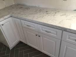 creative home design astounding kitchen snow white cabinets quartz slab mitered edge countertop for tremendous