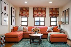 rug adds subtle pattern to the living room with bold orange couch design a