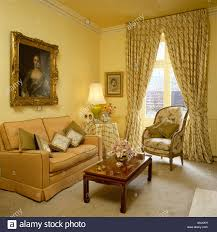 Peach Living Room Large Portrait Above Peach Sofa In Pale Yellow Livingroom With