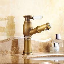 pictures show single hole bathroom faucet antique brass centerset