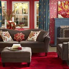 Red And Blue Living Room Interior Living Room Decor Idea With Wall Artwork And Tufted
