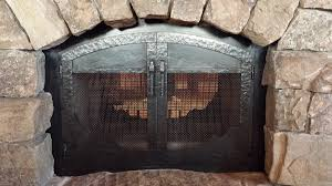 we create custom metal fireplace doors that mix function and design add an element of art and contrast to the masonry work in your home with one of a kind