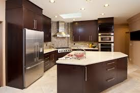 design your own kitchen using dark brown theril kitchen cabinets with silver flat pulls also white granite countertop and white floor tiles