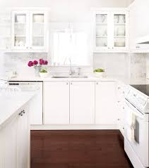 white countertops with white cabinets