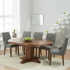 trina dark solid oak round extending dining table with 6 primly grey chairs 7196