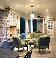 hampton bay area rug bay patio furniture porch traditional with area rug brick fireplace surround ceiling fan ceiling lighting home depot hampton bay