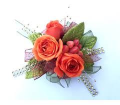 orange berry wrist corsage in schofield wi krueger fl and gifts
