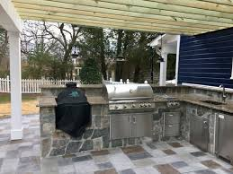 custom outdoor kitchen with big green egg and stainless appliances