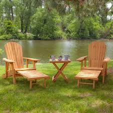nice river scenery with plastic adirondack chairs home depot and green grass also tall green trees