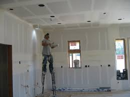 with insulation in place it is time for the interior walls to go up the drywall also known as gypsum board is nailed to the wood framing