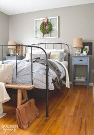 Black iron Ikea bed frame in rustic cottage bedroom ...