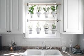 indoor window garden. to fill the gardening void, save some money and make my house prettier, i made an indoor hanging herb garden. it\u0027s definitely one of those pretty-and-useful window garden e