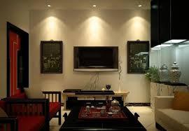 home spotlights lighting. living room with wall mounted lcd tv and led spotlights home lighting